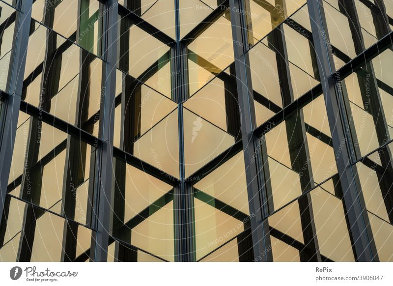 Abstract reflections in the facade of an office building. Facade High-rise Office Office complex Economy real estate technique Architecture Moody Sky