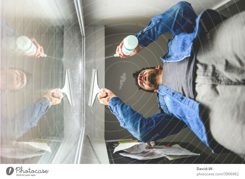 Man cleans the windows - spring cleaning Spring cleaning Window polish Househusband Wipe do the cleaning Cleaning Living or residing Household Diligent