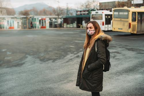 woman with face mask waiting for bus on empty station 2019-ncov auto bus bosnia bus station caution city city life corona coronavirus covid-19 detected disease
