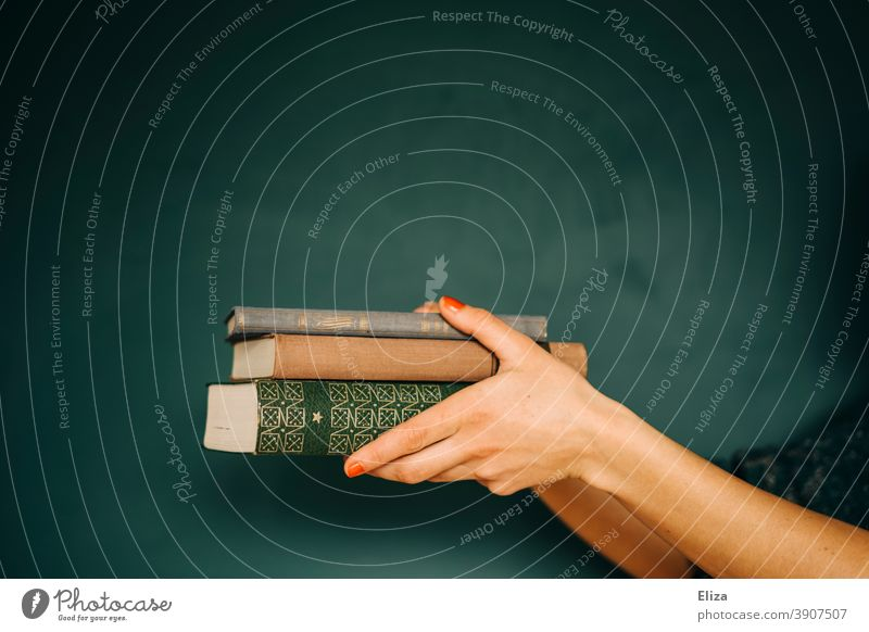 Woman holding a stack of books Stack Study Reading Give hand reading Literature Education Library Reading matter Book Novel Old book collection Green hands
