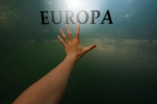 promised land Europe refugee crisis refugee aid Politics and state Glass reflection lettering people Hand Fingers fumble Colour photo Society Graffiti Sign