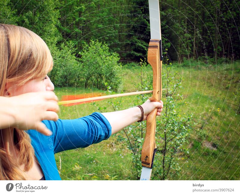 young woman shoots bow in nature. Archery. Recreational sport archery recreational sport arrow and bow Aim Shoot Nature Shot Leisure and hobbies Arrow Weapon