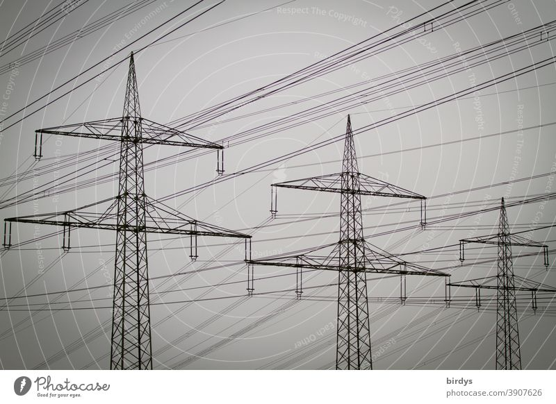 Power pylons with high voltage line in cloudy weather Power poles High voltage power line Electricity Energy industry Electricity pylon power supply Cable Fog
