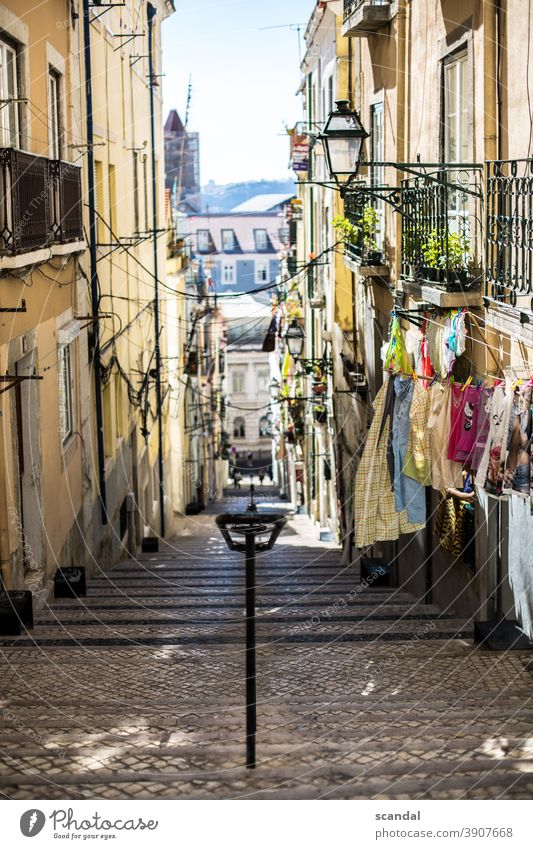 mediterranean street with sky and laundry Mediterranean Street Portugal Lisbon Laundry leash Sky off Cable Terminal connector Lantern daylight Day stagger