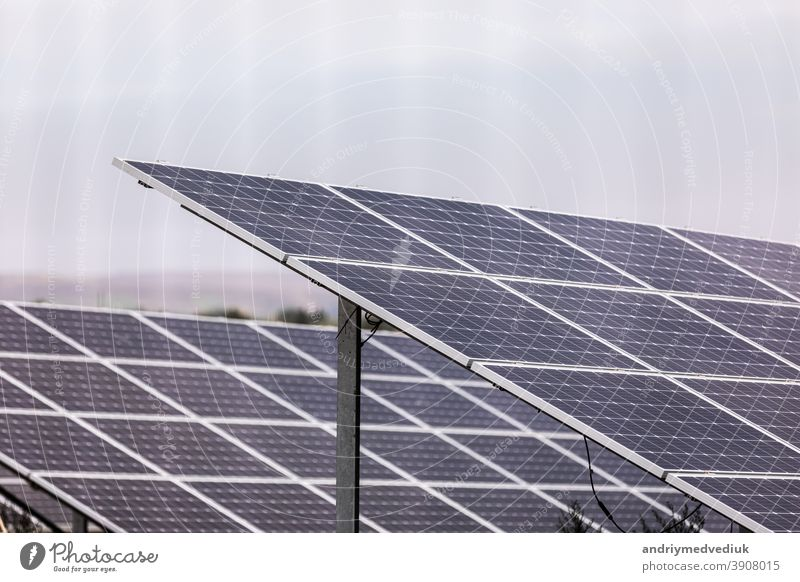 A power plant using renewable solar energy with the sun. Solar cells or photovoltaic cells in solar power plant station turn up skyward absorb the sunlight from the sun. closeup of photo.