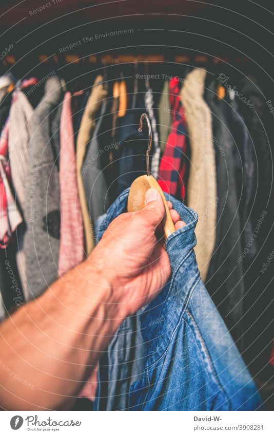 Take clothes out of the wardrobe Attract Closet Decide Shirt Hanger garments Consumption Grasp Hand Man Fashion Style