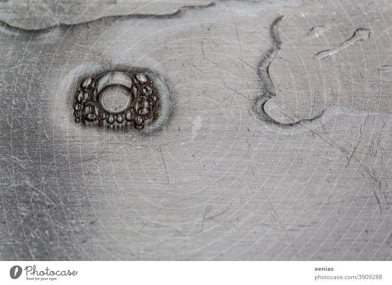 Soap bubbles on the drain surface of a stainless steel sink soap bubbles Sink High-grade steel blow Water Drop Wet Detail Drops of water Foam Glittering Round
