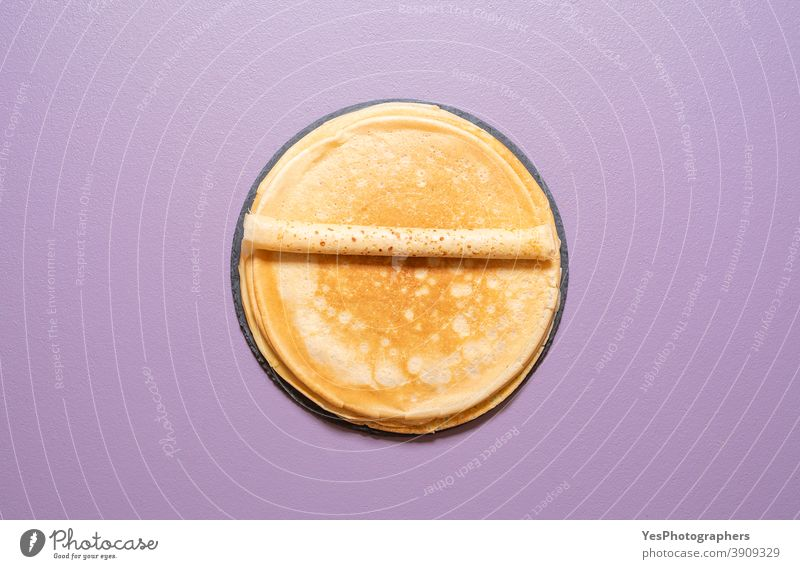 Homemade french crepes above view on a purple background. baked bakery blini breakfast comfort food cuisine cut out dessert dinner eat flat lay fresh gourmet