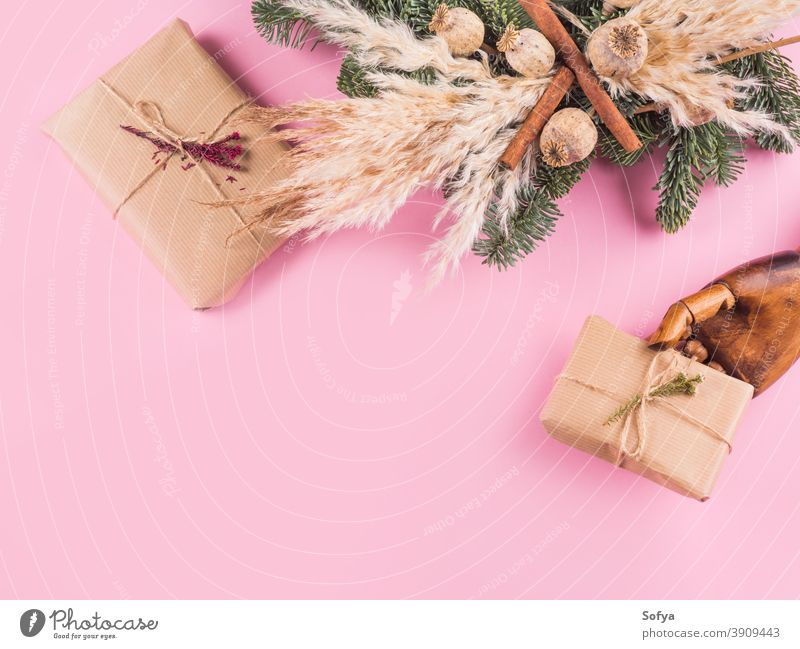 Minimal Xmas flat lay with presents on pink christmas winter hand xmas holding wreath background gift holiday fir year branch boxing new year valentine mother