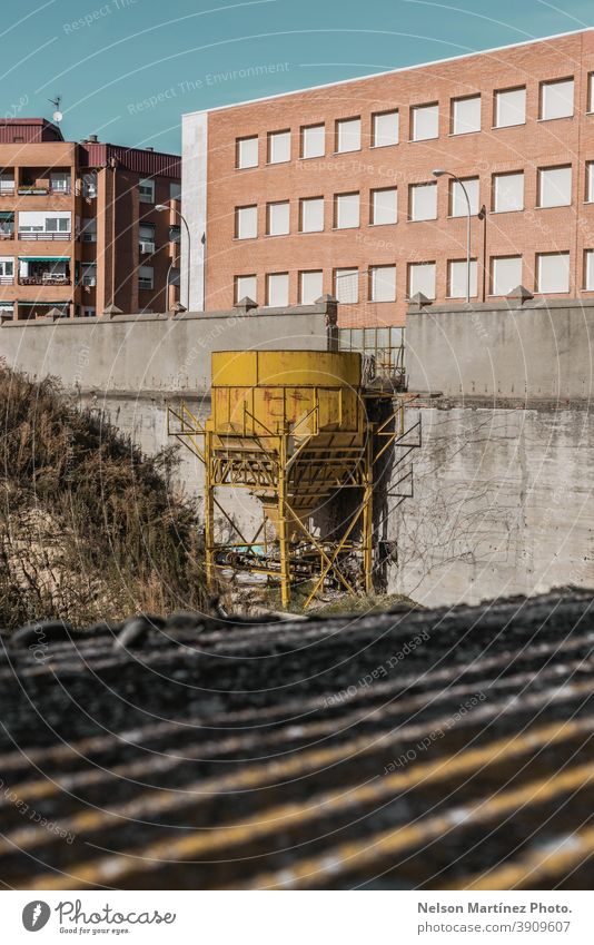 Old yellow industrial water tank. water tower city structure shadows building abandoned outdoor old urban architecture Deserted exterior Building factory nobody
