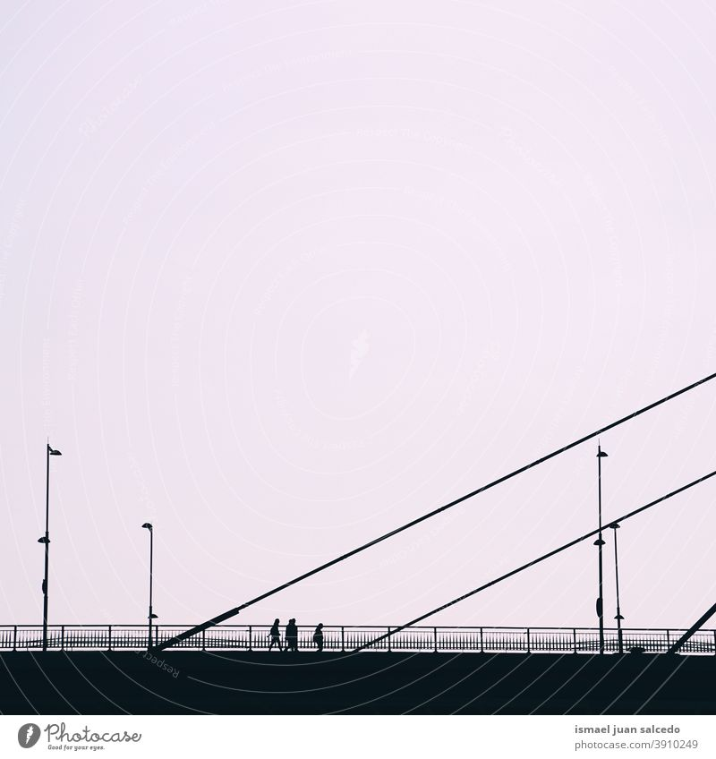 Tourist on the bridge visiting the city of Bilbao, Spain person people Bridge Pedestrian Shadow Silhouette Sunset Street Outdoors City Minimal Action Visit