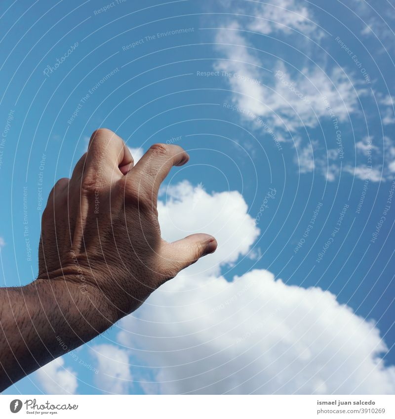 hand and clouds arm fingers skin palm body part sky blue touching feeling reaching pointing gesture gesturing concept freedom Human being Palm of the hand