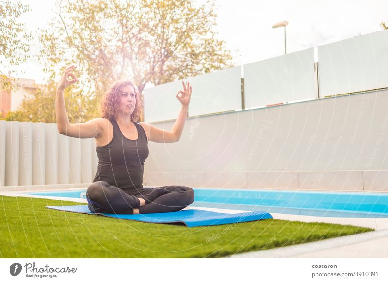 Middle aged woman doing yoga execises in her home garden activity background beautiful body caucasian concentration concept copy space enjoyment exercise female
