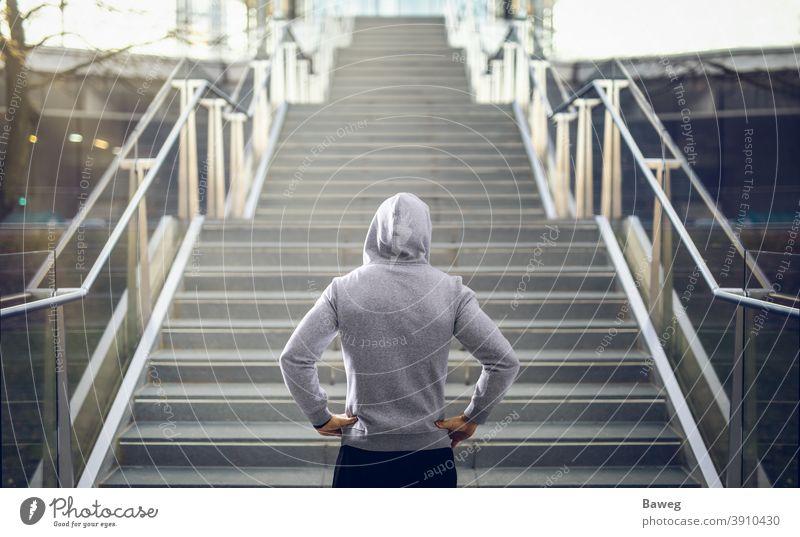 Man in hoodie preparing for stair run. running Stairs Outdoor Hoodie Copy Space Diet Discipline Energy Fitness Health Outside Power Sport Sports Sportswear
