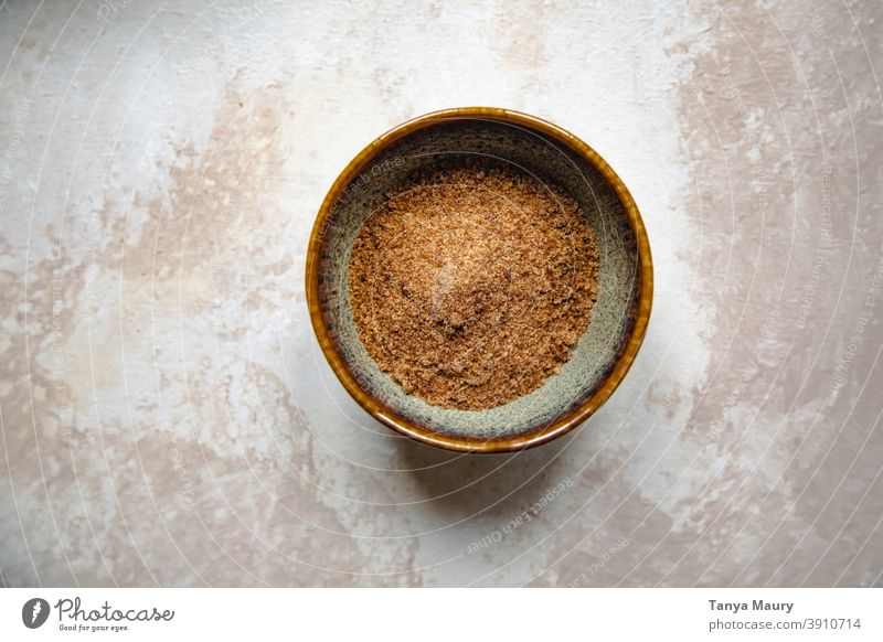 Bowl of brown sugar on a table Sugar Sweet Brown cuisine dessert above view recipe bakery baking workspace home-baked homemade isolated making of minimalist