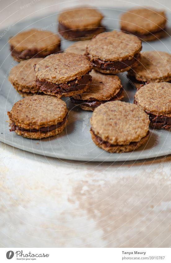 Closeup of vegan and gluten-free sandwich cookies Food photograph Vegan Food Food And Drink food styling Baked goods cookie dough bake cookies Cookie Baking