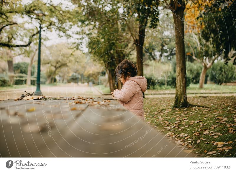Cute child girl playing at the park Autumn Authentic Autumnal Autumn leaves Autumnal colours fall Early fall Nature Colour photo Autumnal weather Exterior shot