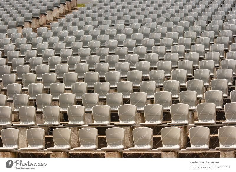 rows of plastic seats in the stadium event chair empty concert seating nobody background sport pattern stand bench audience section horizontal theater color
