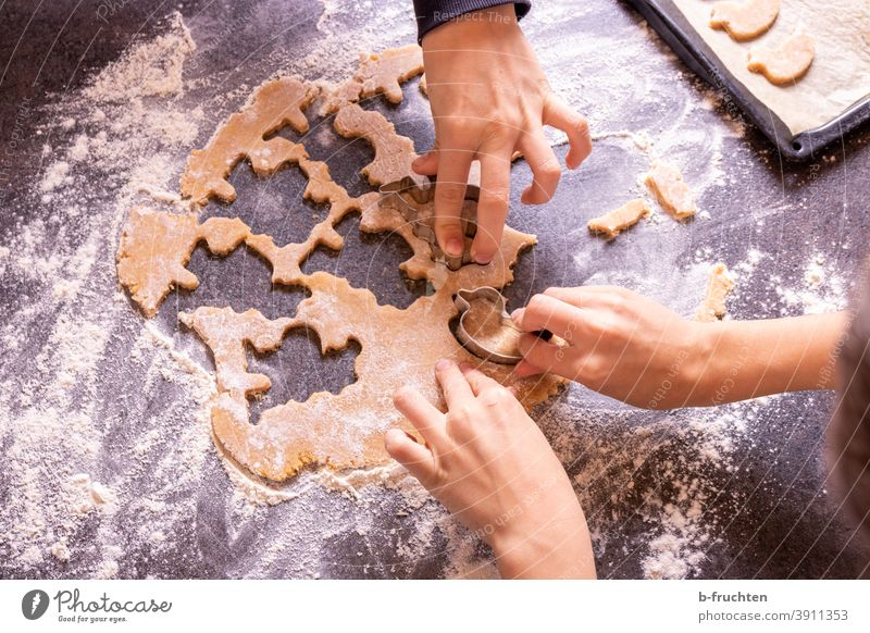 Cutting out children at biscuits children's hands Cookie cute Delicious Baking Baked goods Christmas biscuit Christmas & Advent cookie cutter cookie dough