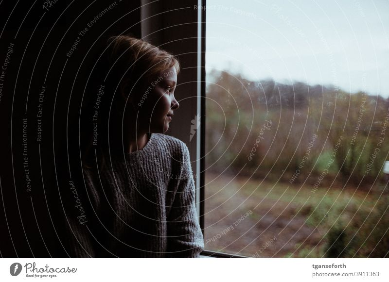 Child looks thoughtfully out the window Window Girl Infancy Looking Human being Colour photo Interior shot portrait 1 Autumn Meditative Thinking Observe