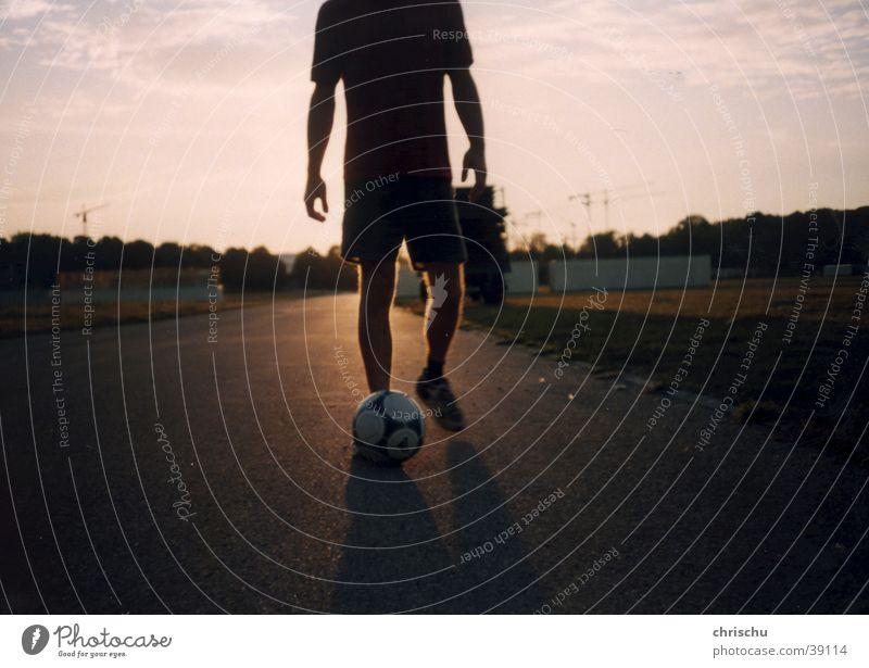 football romance Munich Theresienwiese Tom Tom Back-light Long exposure Asphalt Sports Street Soccer Soccer player
