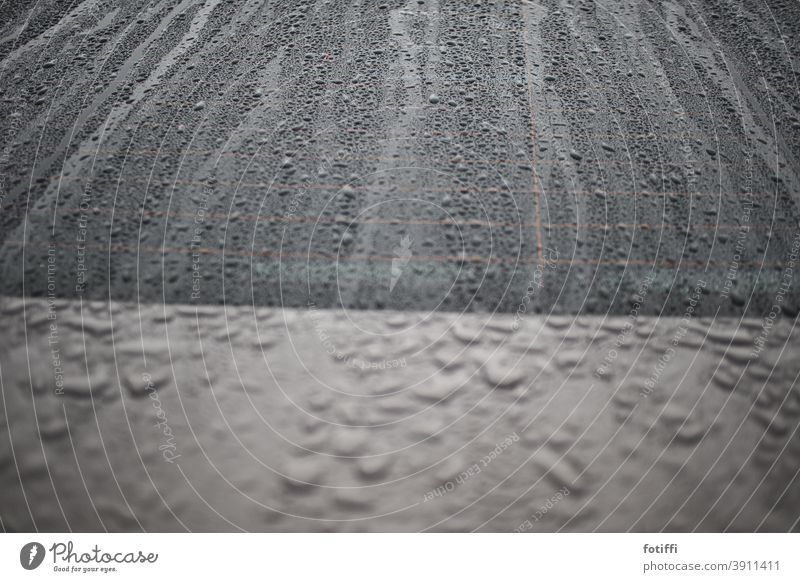 Drops like sand on the sea Rain raindrops car Wet Drops of water Weather Detail Bad weather Deserted Autumn Gray Exterior shot Car Window Window pane