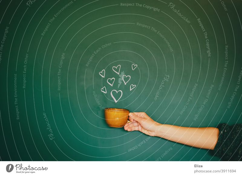 Hand holding a cup from which hearts come out Cup cuddle Coffee Tea Delicious Love Positive Hot drink enjoyment To enjoy Coffee cup Break warm