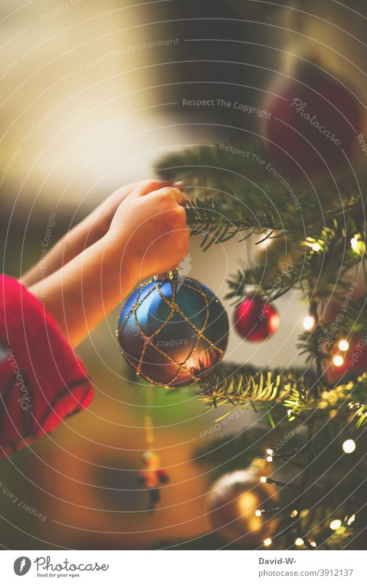 Child decorates the Christmas tree Christmas & Advent ornament Glitter Ball Anticipation Christmas tree decorations Tradition Hand cautious