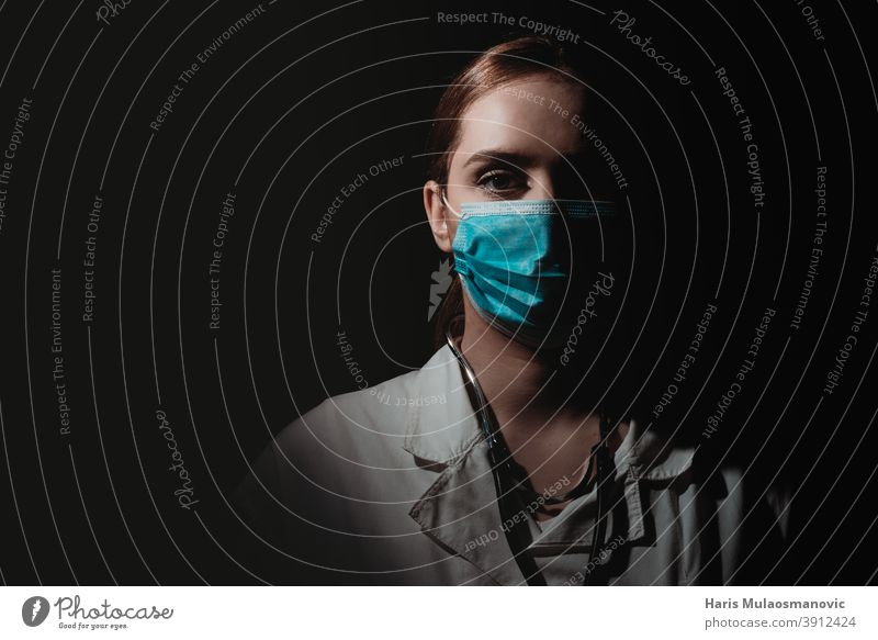 female doctor with face mask on black background brazil corona epidemic corona virus coronavirus covid-19 covid-19 test dark doctors emotion europe hard work