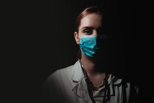 female doctor with face mask on black background brazil corona epidemic corona virus coronavirus covid-19 covid-19 test dark doctors emotion europe hard work