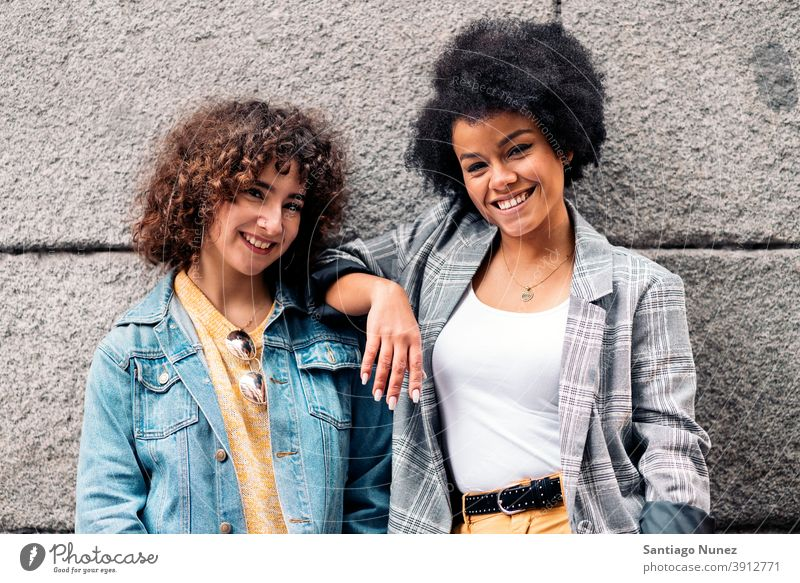 Cool Afro Girl and Friend Smiling women looking at camera street multi-ethnic afro girl caucasian portrait having fun front view friends friendship multiethnic