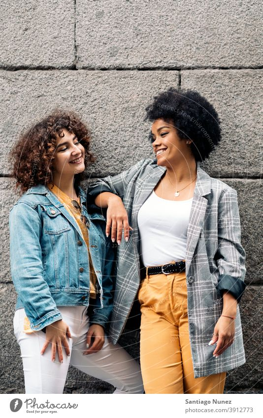 Cool Afro Girl and Friend in Street women looking at each other street multi-ethnic afro girl caucasian portrait having fun front view friends friendship