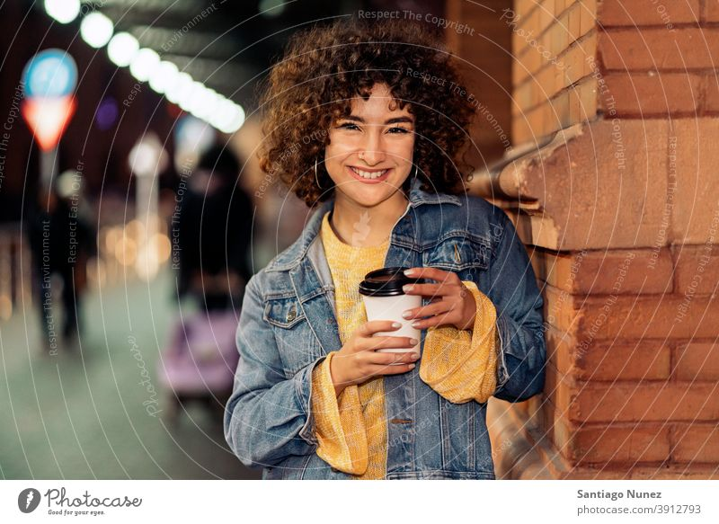 Young Girl With Short Hair Portrait cup of coffee curly hair caucasian portrait looking at camera smiling street woman young expression front view one person