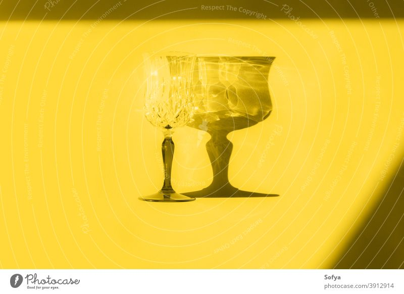 Illuminating yellow flat lay with glass and shadow gray color illuminating grey year ultimate stemmed monochrome minimal drink new year design style geometry