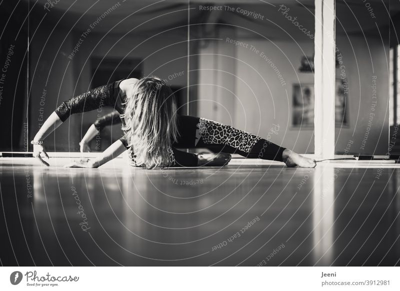 Dance training of a woman in dance studio | reflection in background in black and white Woman Young woman gymnastics Relaxation Feminine Sun Silhouette Light