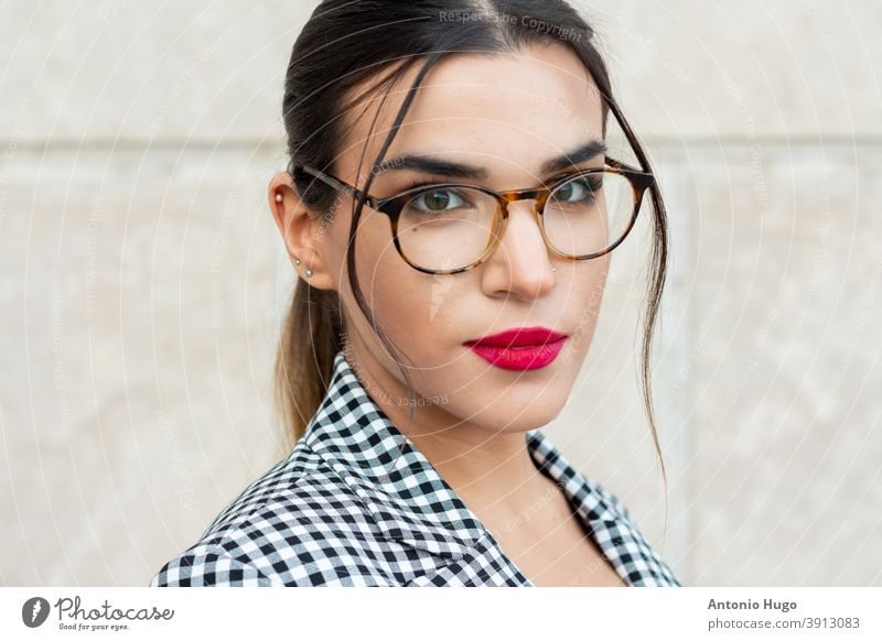 Portrait of a young brunette businesswoman with red painted lips and glasses. Business and technology concept. red lips eyeglasses sexy sensual corporate