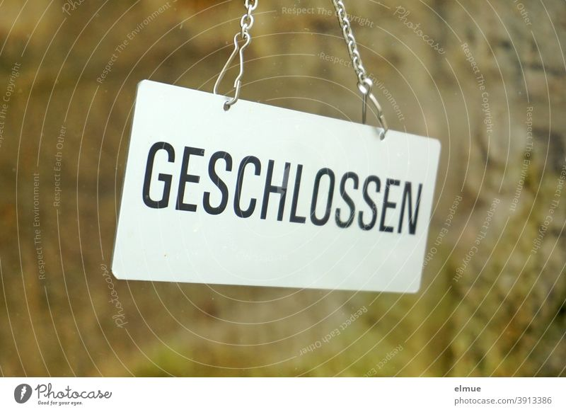 "Behind a glass pane hangs a sign ""GESCHLOSSEN"" / lockdown / Corona crisis Closed Hang Glass door Pane corona crisis Signage Load business prevention shutdown"