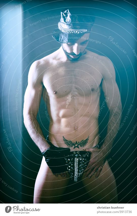 erotic photo of a man Man Naked cap nude upper body gay tattoo schnauzer Facial hair Underpants string string thong Thong Trickle glitter Model Sex sexy