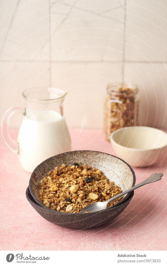 Breakfast with granola and milk breakfast food healthy organic cereal fruit muesli berry bowl grain diet flake snack yogurt fresh natural sweet dessert oat seed