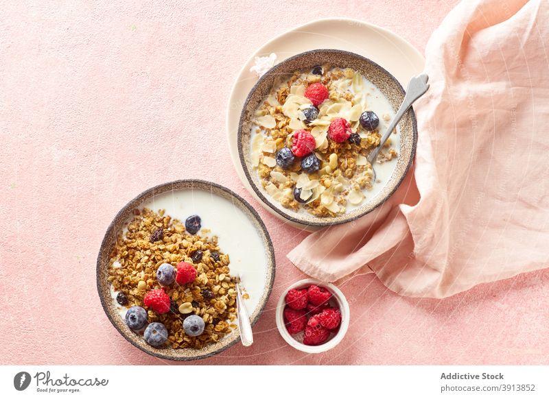 Breakfast with granola, berries and milk breakfast food healthy organic cereal fruit muesli berry bowl grain diet flake snack yogurt fresh natural sweet dessert