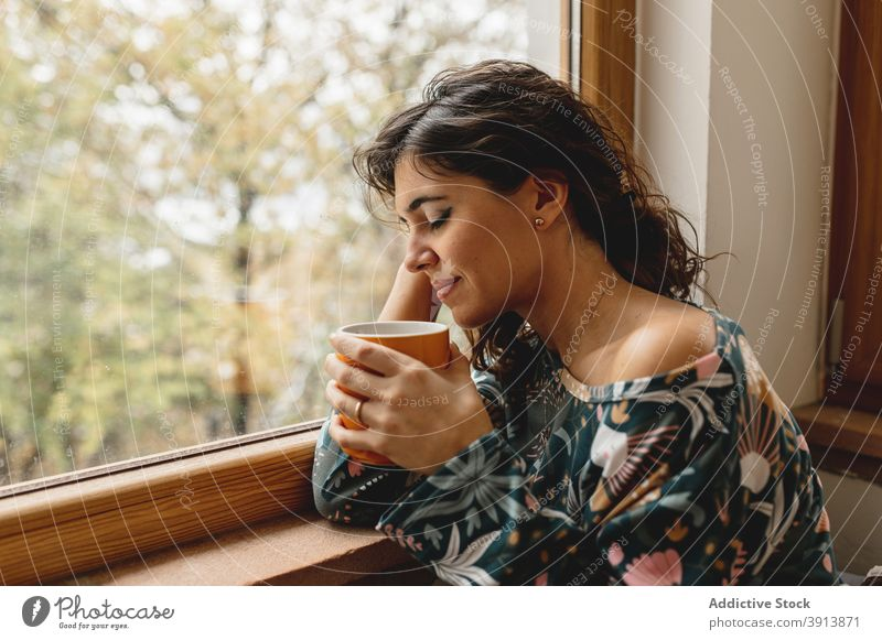 Close up caucasian attractive woman portrait smiling while drinking a cup of hot beverage. sleepwear vacancy cozy rural girl looking tea person coffee rest snow