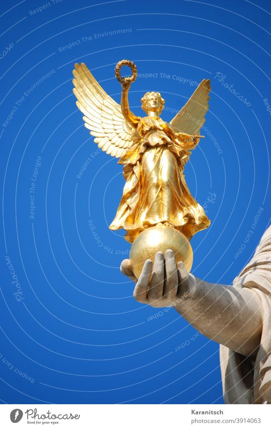Golden Nike in the hand of Pallas Athena. golden Goddess of victory Figure laurel wreath Grand piano Hand stop Statue Sky Blue clear Vienna Parliament