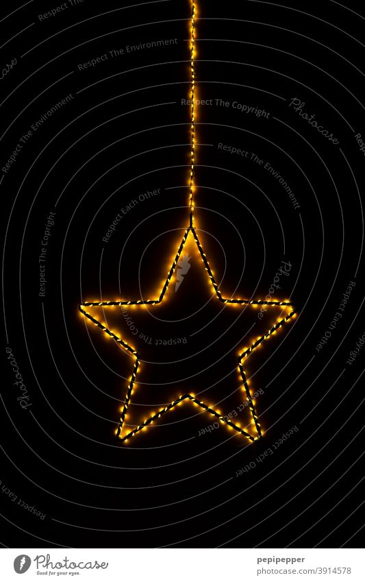 burning star, light chain wrapped around a star Stars Fire Burn Blaze Flame Hot Warmth Christmas & Advent Light Yellow Feasts & Celebrations Dark Ignite