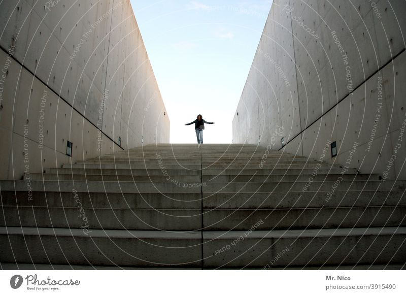 come down stay on top Woman Feminine Sky Architecture Building Manmade structures Stairs Wall (building) Wall (barrier) Cool (slang) Concrete wall Downward