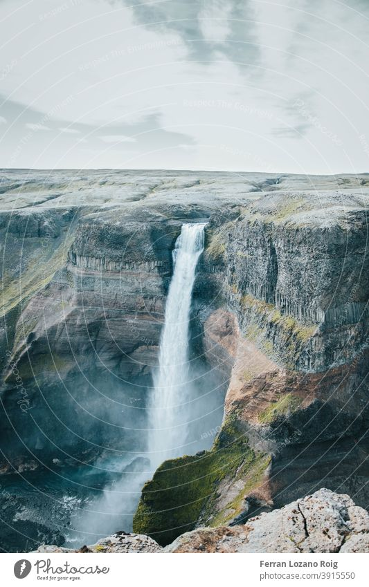 Amazing waterfall in Iceland iceland mountain rock rocks mountains height color clouds landscape nature