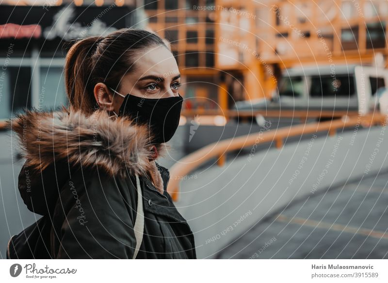 woman with face mask outdoors in the city adult attractive beautiful beauty blonde bus station caucasian confident coronavirus covid-19 croatia disease epidemic