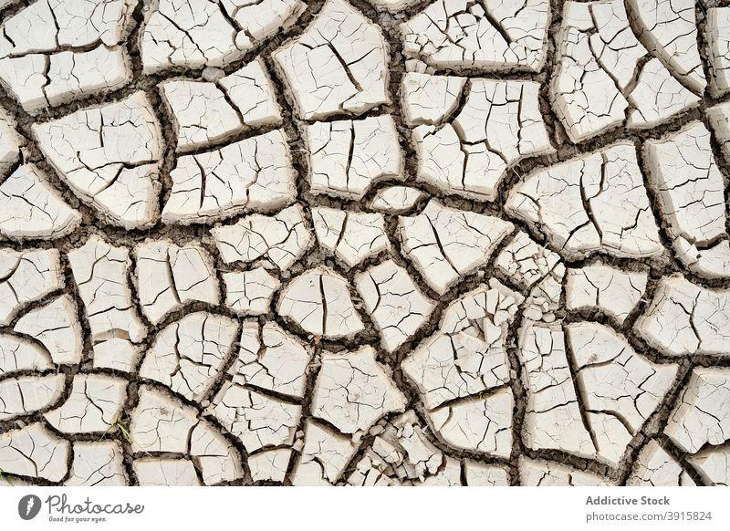 Texture of dried cracked soil drought texture barren waterless background uneven arid dry surface earth nature desert grunge damage terrain environment dirt
