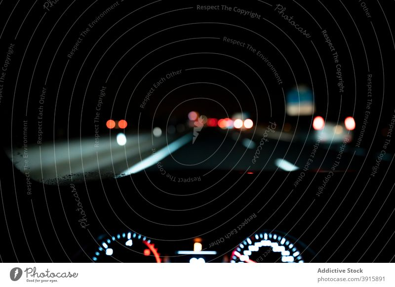 Car driving on night roadway car drive dashboard panel dark illuminate windshield auto trip highway vehicle transport automobile speed route windscreen travel