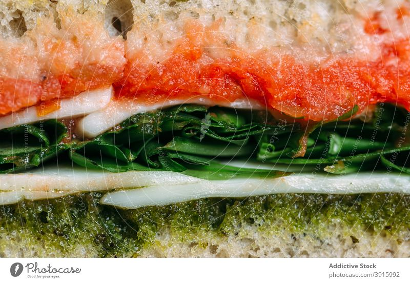 Macro image of healthy sandwich turkey with pesto sauce lunch bread food snack breakfast meal tomato fresh toast dinner vegetable background delicious gourmet