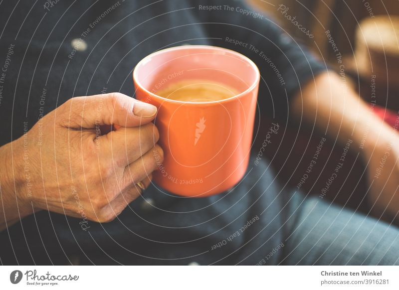 Sitting relaxed in the armchair, a cup of coffee in your hand... So the weekend can begin ... Coffee mug Hand To hold on Hot drink Cup Mug stop Cappuccino